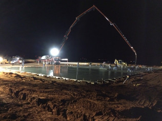 Placing concrete with a pump truck in the early morning hours
